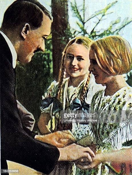 Young aryan type german girls shown greeting Adolf Hitler Bavaria germany 1934