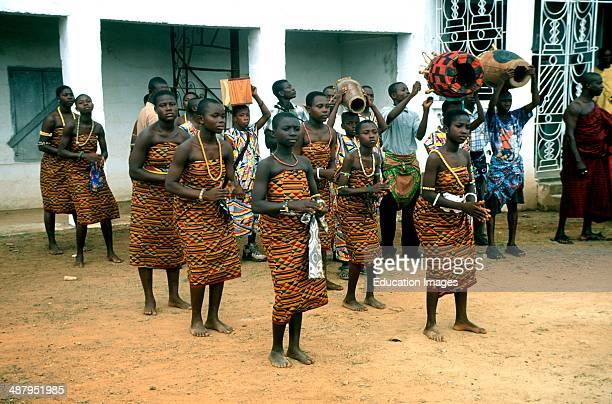 Young Ashanti girls wearing kente cloth dance for the king at a royal durbar in Kumasi in the Ashanti Region of Ghana West Africa