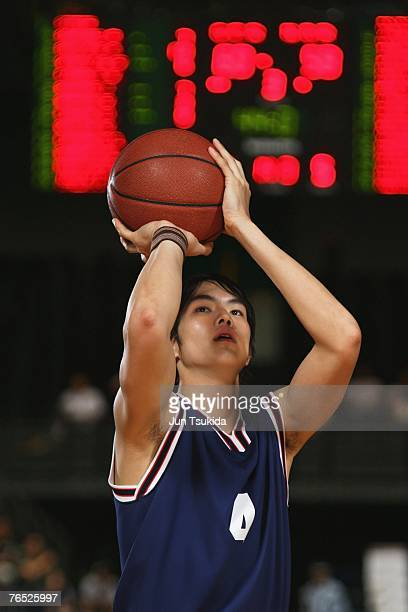Young Asian basketball player with ball