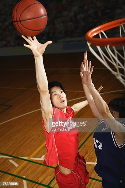 Young Asian basketball players on court