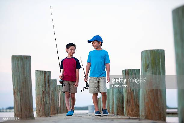 Young Asian Brothers on a Fishing Pier