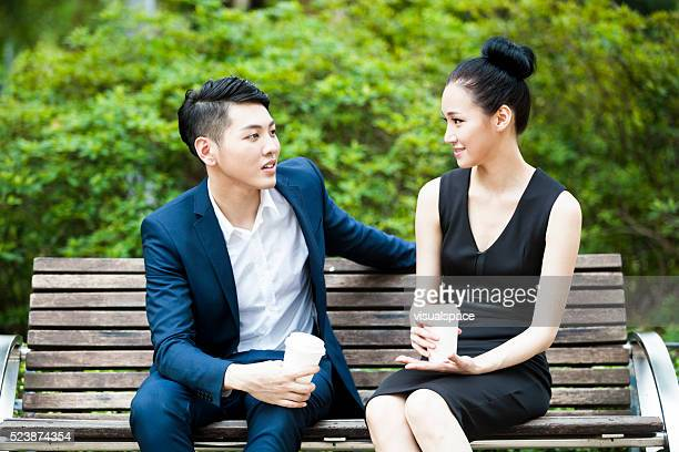 Young Asian Business Colleagues Drinking Coffee Together Outdoors