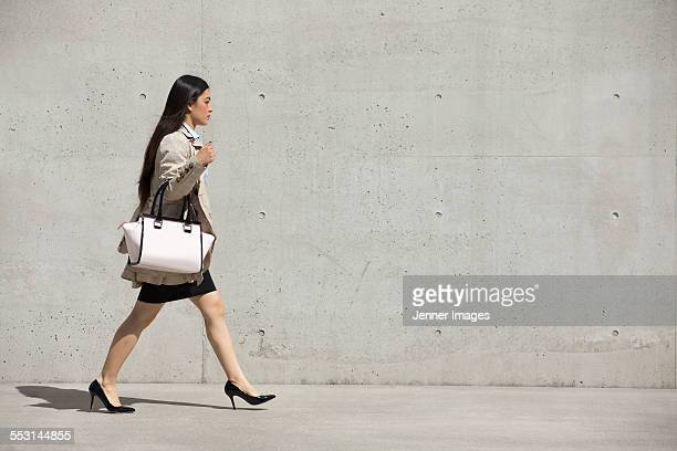 Young asian business woman walking.