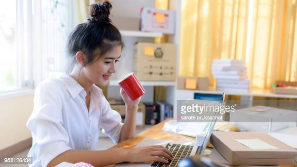 Young Asian Business Woman Working Business Online at home