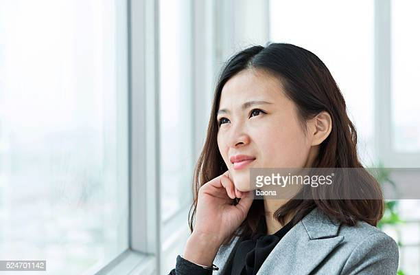 Young asian businesswoman in office