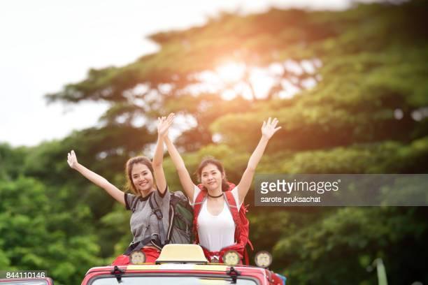Young Asian Camper Enjoy adventure Travel, Forest Park Outdoors . Holiday , vacation , summer concept .