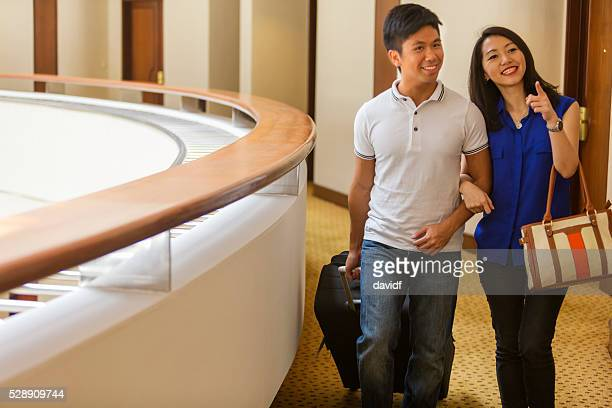 Young Asian Couple Arriving at a Hotel On Vacation