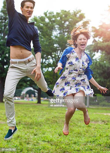 Young asian couple having fun in the park, Tokyo.