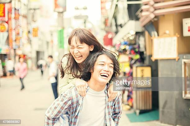 Young asian couple having fun