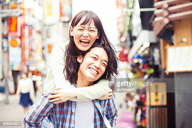 Young asian couple having fun
