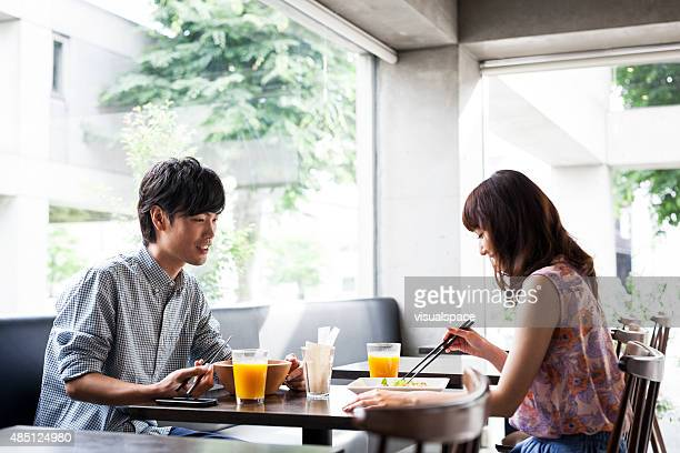 Young asian couple having lunch