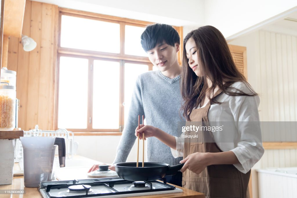 young asian couple in kitchen : Stock Photo