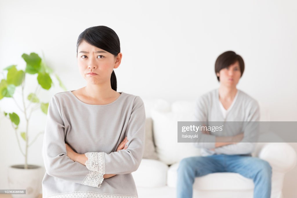 young asian couple in living room lifestyle image : Stock Photo