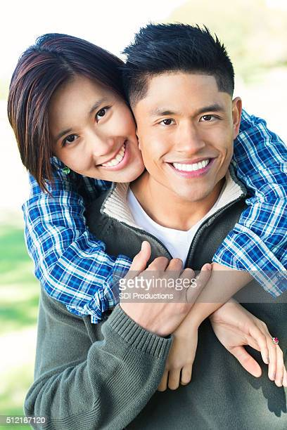 Young Asian couple in the park