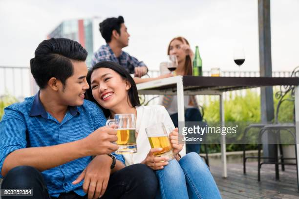 Young asian couple relaxing together at a party