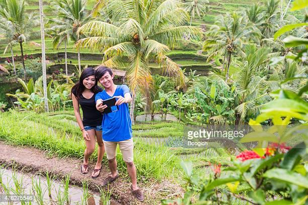 Young Asian Couple Take Selfie Ubud Rice Terrace Bali Indonesia