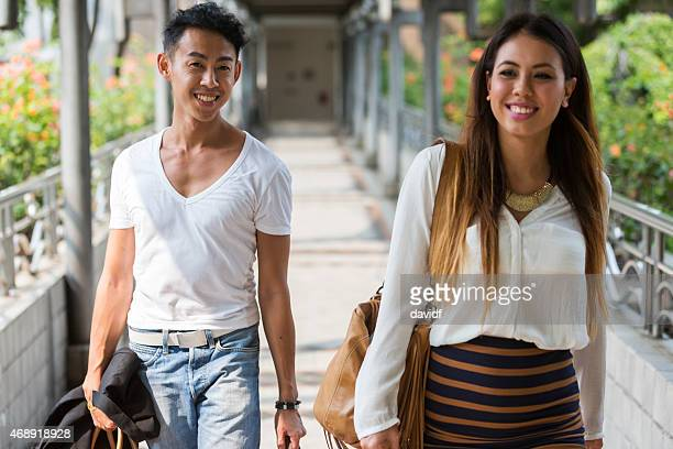 Young Asian Couple Walking in Singapore