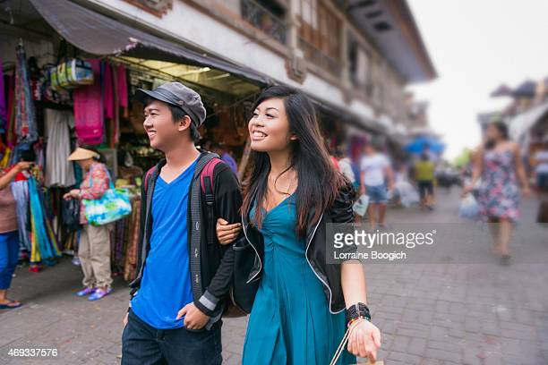 Young Asian Couple Walking in Ubud Market Outdoors Bali Indonesia