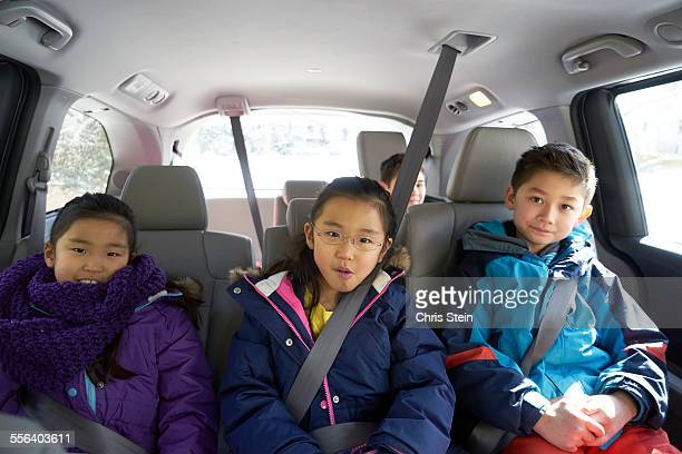 young asian cousins driving around  in a minivan t - vehicle interior stock pictures, royalty-free photos & images