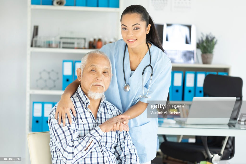 Young asian doctor and her patient in cabin : Stock Photo