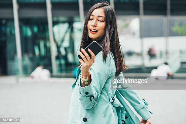 young asian ethnicity woman with smart phone - smart casual stock pictures, royalty-free photos & images