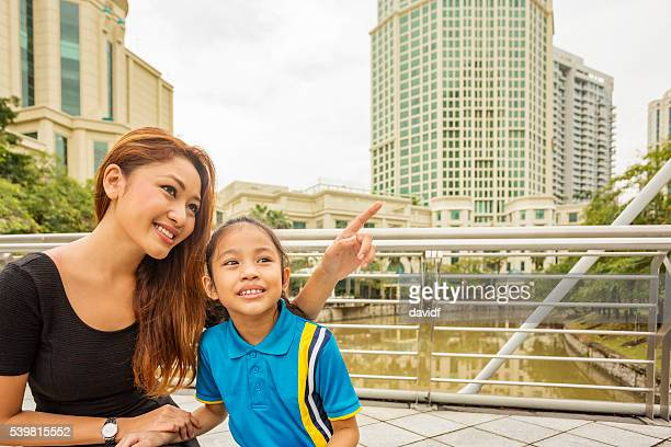 Young Asian family sightseeing in Singapore