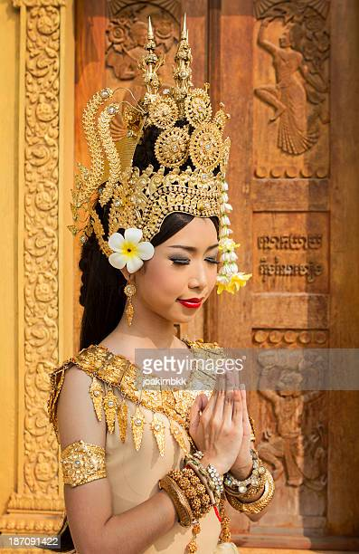 young asian female apsara dancer praying - khmer art stock photos and pictures