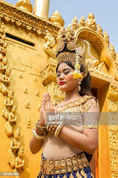 young asian female apsara dancer praying - cambodian culture stock photos and pictures