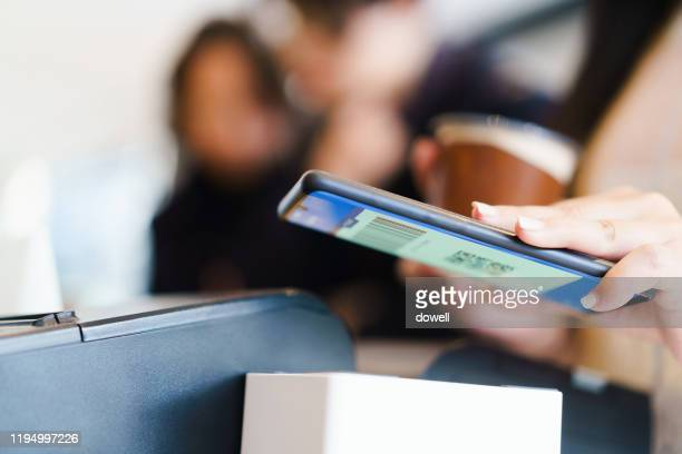 young asian female contactless payment with smart phone - nfc stock pictures, royalty-free photos & images