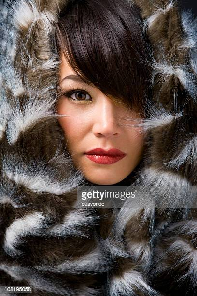 Asian Young Woman in Eskimo Fur Beauty Close Up