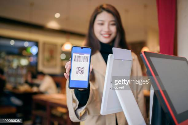 young asian female payment with qr code in smart phone - nfc stock pictures, royalty-free photos & images