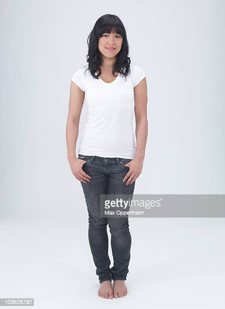 young asian female with hands in pockets  - 白tシャツ ストックフォトと画像