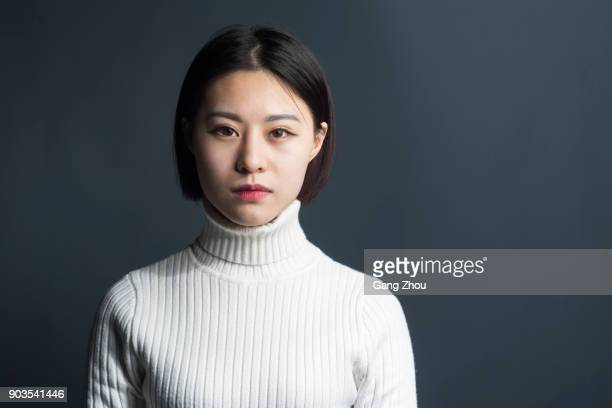 young asian female,portrait - serious stock pictures, royalty-free photos & images