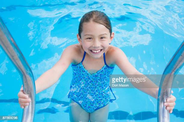 Young Asian girl in swimming pool