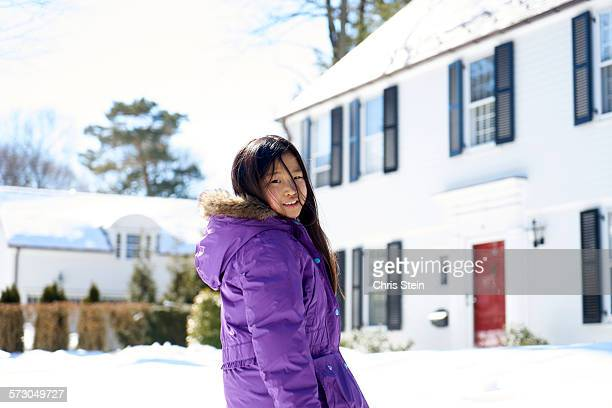 Young Asian girl out in the snow