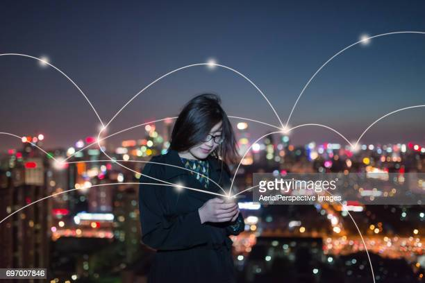 Young Asian Girl Using Smartphone and Smart Life