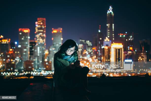Young Asian Girl Using Smartphone in urban city