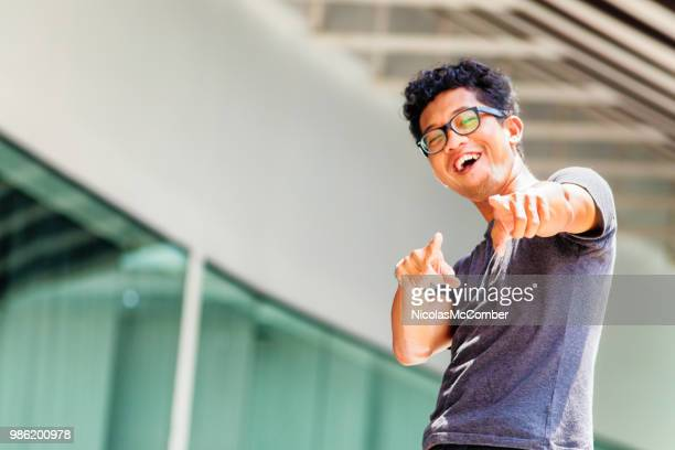 young asian intellectual man urban pointing fun portrait with eyeglasses - sneering stock pictures, royalty-free photos & images