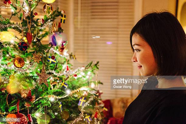 Young Asian looking at the Christmas decorations