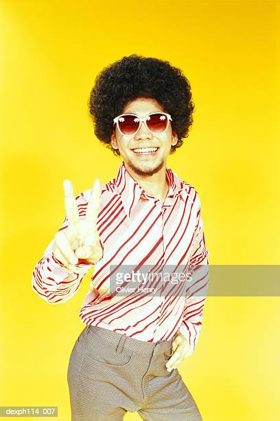 Young Asian male with afro hair in dancing pose