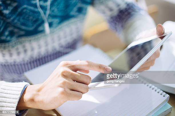 young asian man studying by tablet in classroom
