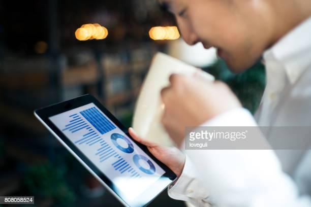 young asian man using digital tablet
