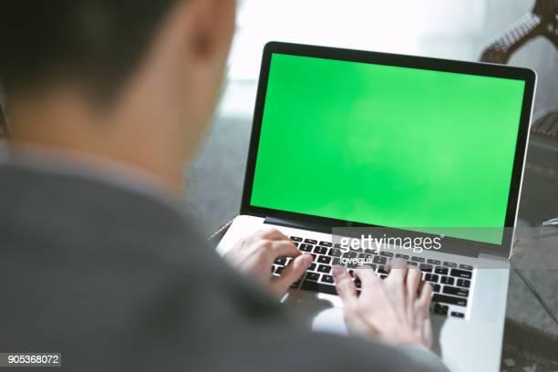 young asian man using laptop - chroma key foto e immagini stock
