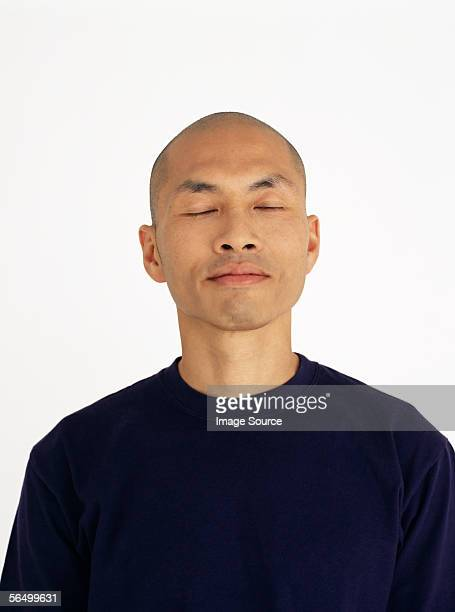 young asian man with his eyes closed - hair loss stock pictures, royalty-free photos & images