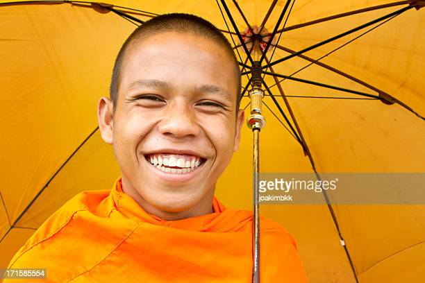 Young Asian monk smiling