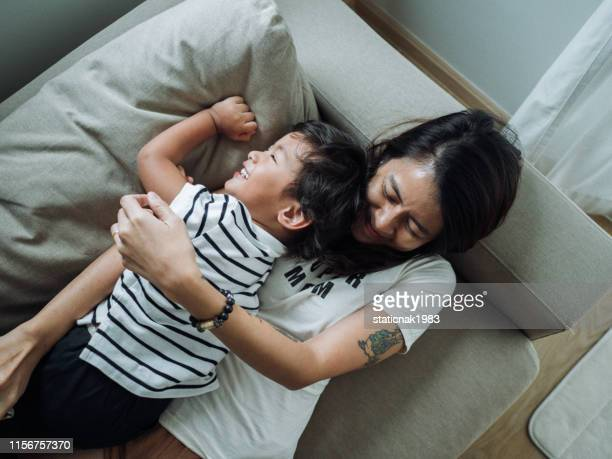 young asian mother with adorable son - one parent stock pictures, royalty-free photos & images