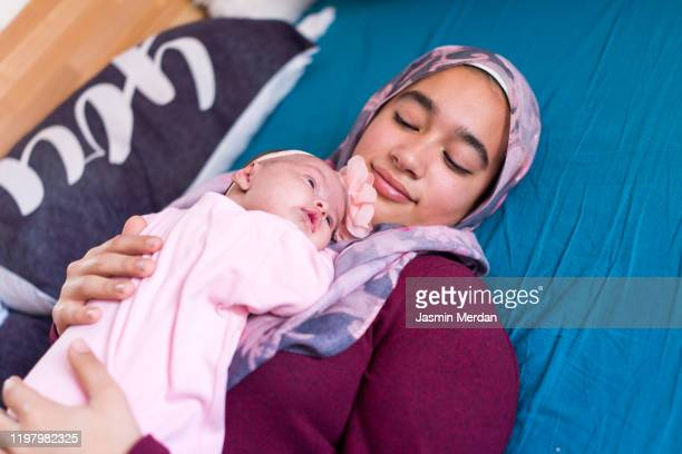 young asian mother with baby - bangladesh mother stock pictures, royalty-free photos & images