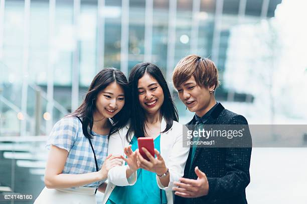 Young asian people making selfie on street