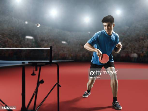 young asian ping pong player playing table tennis game - table tennis stock pictures, royalty-free photos & images