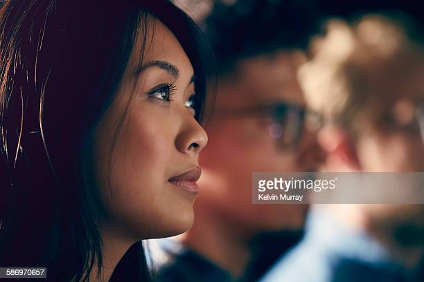 a young asian professional watches presentation - employee stock pictures, royalty-free photos & images